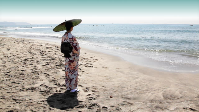 japanese woman standing by the sea - parasol stock videos & royalty-free footage