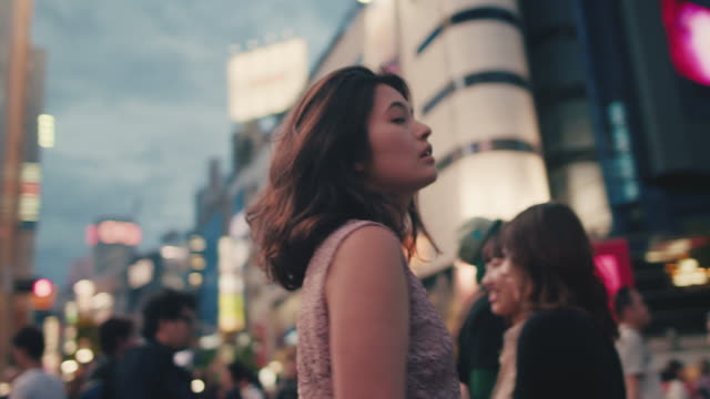 japanese woman standing in the middle of busy intersection / tokyo, japan - generation z stock videos & royalty-free footage