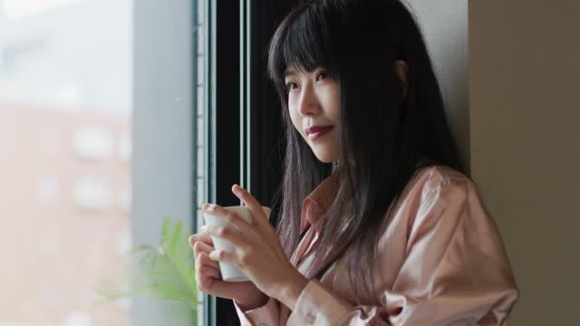 a japanese woman stands contemplating / tokyo, japan - bronek kaminski stock videos & royalty-free footage