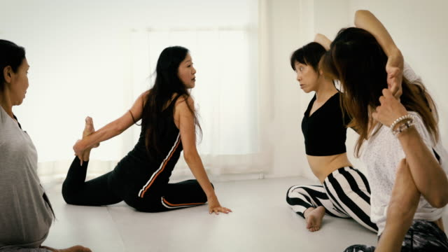 japanese woman stretching during yoga class - wellbeing stock videos & royalty-free footage