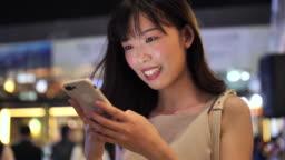 Japanese Woman using phone at night