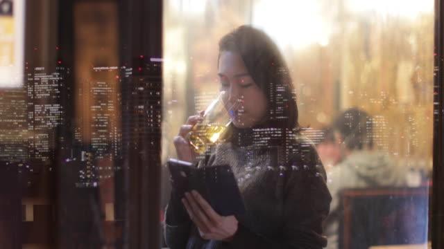 Japanese woman using smart phone at night. Tokyo, Japan