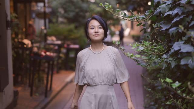 japanese woman walking in narrow street - hairstyle stock videos & royalty-free footage