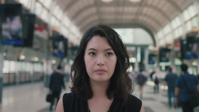 Japanese woman walking in train station in Tokyo, Japan