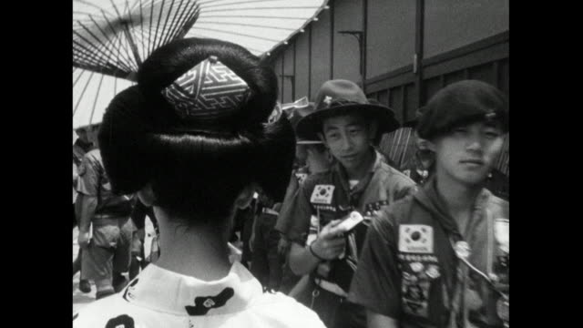 japanese woman walking on street carrying umbrella; 1966 - femininity stock videos & royalty-free footage