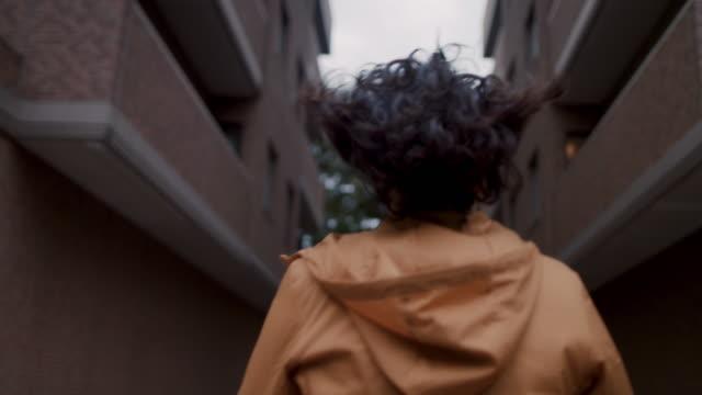 japanese woman wearing hooded jacket walking in tokyo, japan. - casual clothing stock videos & royalty-free footage