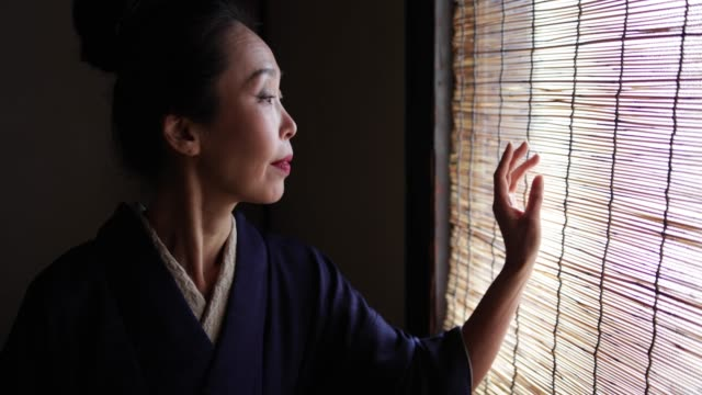 japanese woman wearing kimono looking out traditional window, kyoto japan - blinds stock videos & royalty-free footage