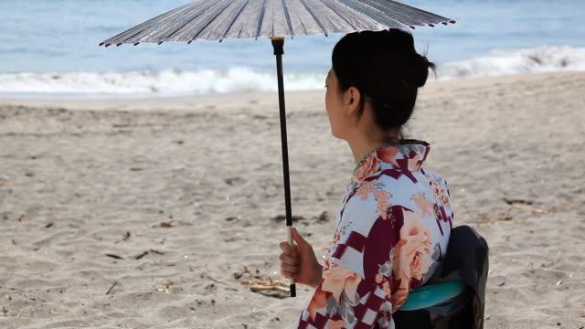 japanese woman with a parasol enjoying sea - parasol stock videos & royalty-free footage