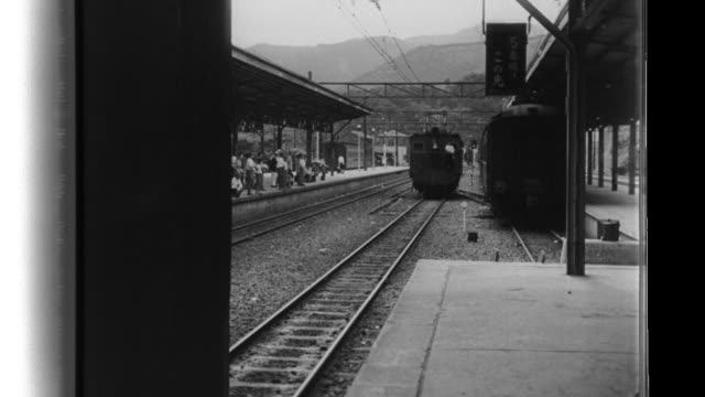 japanese women aid the war effort as they train or work at passenger and freight railroad jobs and also drive trucks and perform related teamster... - bahnreisender stock-videos und b-roll-filmmaterial