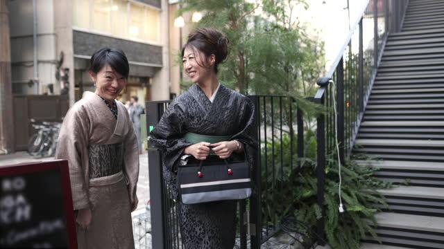 japanese women in kimono entering outdoor cafe - three quarter length stock videos & royalty-free footage