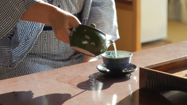 japanese women in traditional kimono drinking tea , kyoto japan - tea pot stock videos and b-roll footage