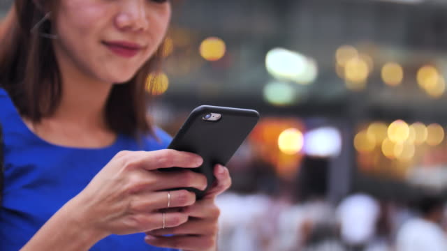 japanese women using smartphone at dusk - telecommunications equipment stock videos and b-roll footage