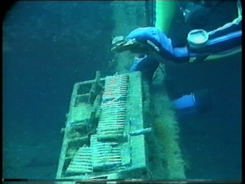 japanese wwii fleet wreck underwater ms debris on wreck cms gas masks on seabed ms barnacle encrusted operating table from hospital ship on seabed... - ammunition stock videos & royalty-free footage