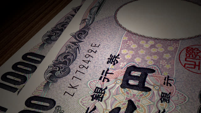 japanese yen bills rotating on the table - animation