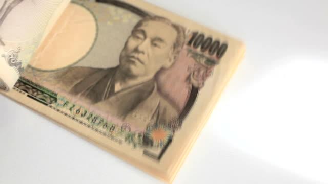 vidéos et rushes de yen japonais - symbole du yen