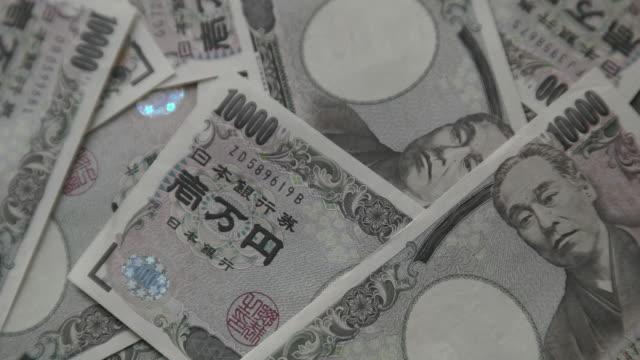 japanese yen. - 紙幣点の映像素材/bロール
