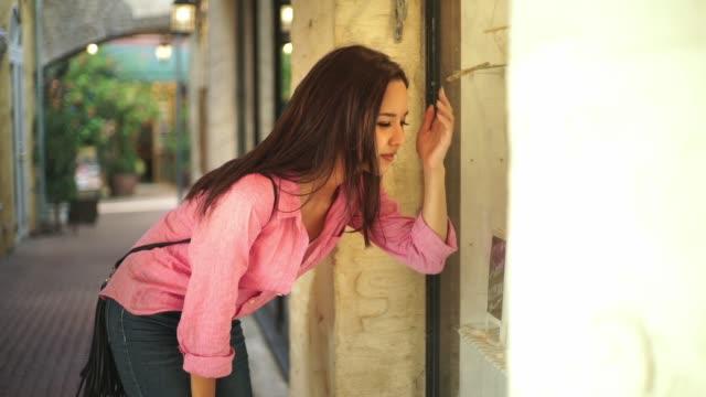 Japanese young female enjoy window shopping.