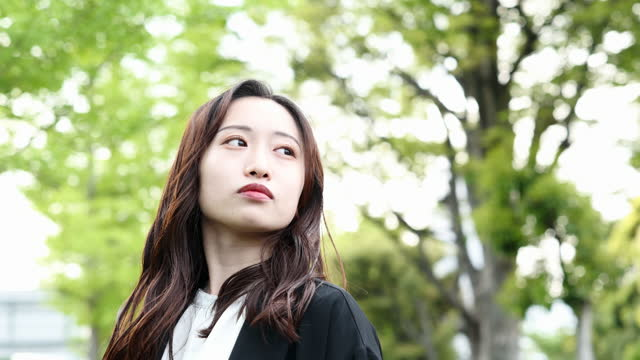 japanese young woman see back with a will on a sunny day - looking away stock videos & royalty-free footage
