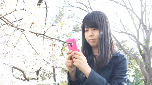 japanese young woman strolling in tokyo - one teenage girl only stock videos & royalty-free footage