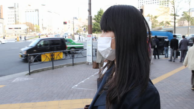 japanese young woman strolling in tokyo - smog video stock e b–roll