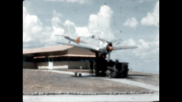 a japanese zero fighter plane is on display in front of the operations building at clark airbase during wwii - 1946 stock videos & royalty-free footage