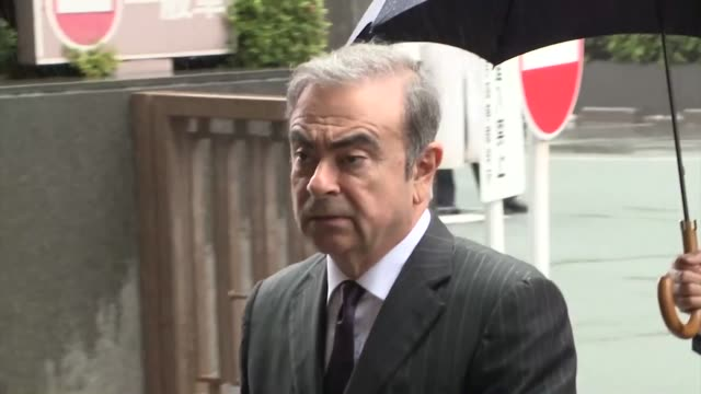 former nissan motor co chairman carlos ghosn heads to the tokyo district court on june 24 to attend a pretrial proceeding being held to narrow down... - narrow stock videos & royalty-free footage