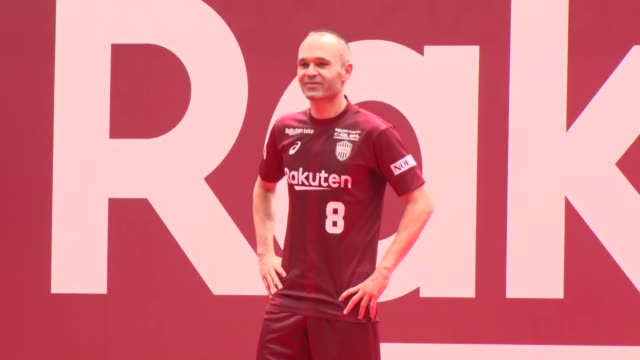 Barcelona legend Andres Iniesta who signed his contract with JLeague side Vissel Kobe in Tokyo on May 24 acknowledges fans at a welcome ceremony at...