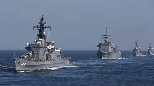 japan's maritime self defense force destroyer ship kurama left leads a troop of vessels during a review at sagami bay off yokosuka kanagawa... - japan self defense forces stock videos and b-roll footage