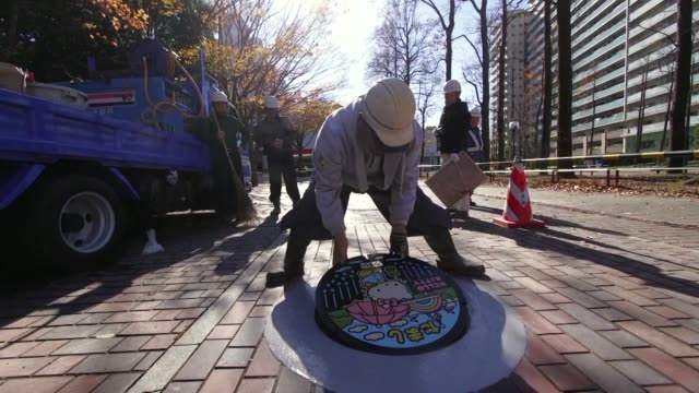 japan's sewerage industry has found a way to clean up its dirty and smelly image elaborately designed and colourful manhole covers with 12000 local... - hello kitty stock videos and b-roll footage