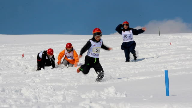 japan's snow athletics competed on snow features snowshoe race and tugofwar among others at mamurogawa town in northern yamagata prefecture the... - yamagata prefecture stock videos & royalty-free footage