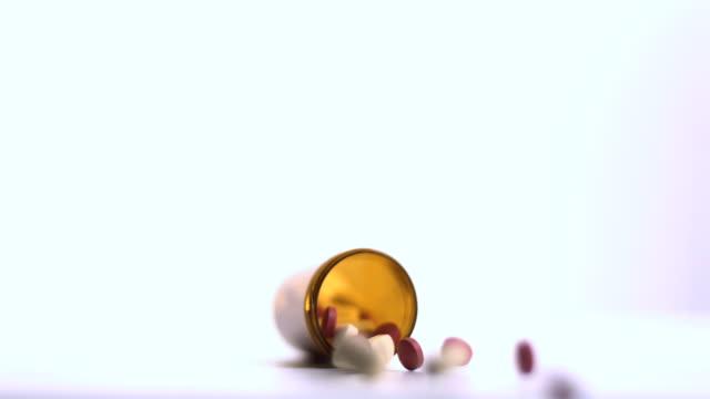 Jar of medicine knocking over