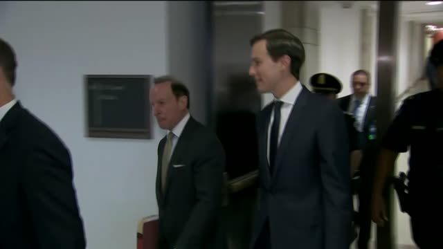 Jared Kushner walks with an escort along a hallway and then out an elevator towards a room to interview with members and staff of the House Permanent...