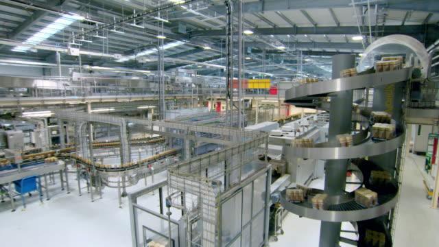 jars of freeze dried coffee on factory production line - 生産ライン点の映像素材/bロール