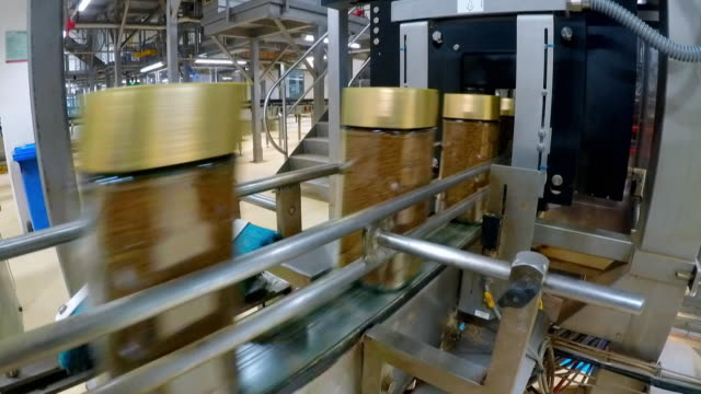 jars of freeze dried coffee on factory production line - large group of objects stock videos & royalty-free footage