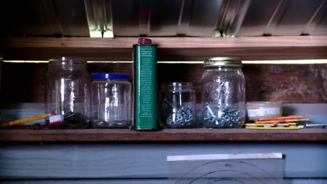 cu jars on shelf in workshop, live oak, florida, usa - einige gegenstände mittelgroße ansammlung stock-videos und b-roll-filmmaterial