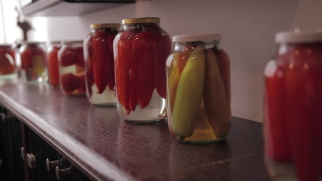jars with pickled vegetables and on wooden shelf - canning stock videos & royalty-free footage