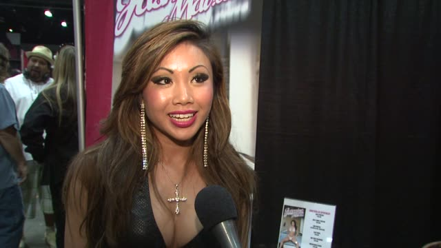 jasmine mai on the recent hiv scare in the adult film industry and how adult films can open doors for couples. at the erotica 2009 at los angeles ca. - retrovirus video stock e b–roll