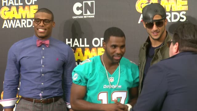 Jason Derulo Colin Kaepernick and Cam Newton at Cartoon Network Hosts Fourth Annual Hall Of Game Awards at Barker Hangar on February 15 2014 in Santa...