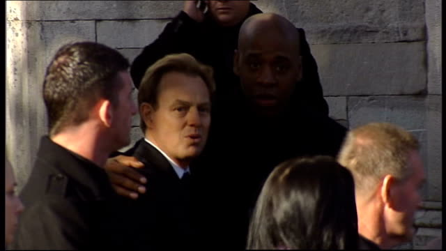stockvideo's en b-roll-footage met jason donovan arriving at funeral louis walsh arriving at church stephen gately's parents into church andrew cowles along into church - boyzone