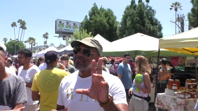 interview jason george talks about being mistaken for a doctor while on a flight while shopping at the farmer's market in studio city in celebrity... - jason george stock videos and b-roll footage