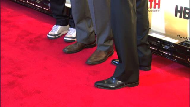 jason schwartzman, jonathan ames and ted danson posing for paparazzi on the red carpet. - テッド・ダンソン点の映像素材/bロール
