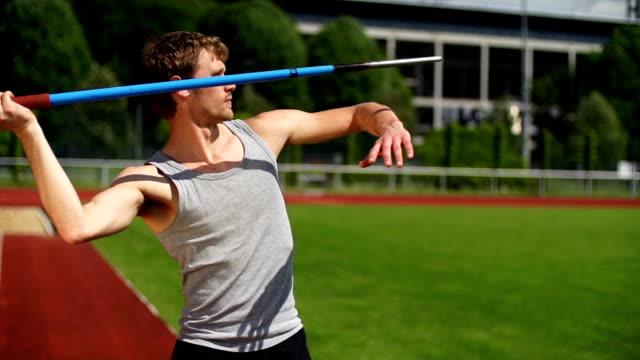 slow motion: javelin thrower - javelin stock videos & royalty-free footage