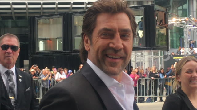 javier bardem greets fans before entering the red carpet in the roy thomson hall he is the city for the premiere of the movie everybody knows the... - javier bardem stock videos and b-roll footage