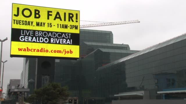 javits center marquis and exterior. marquis shows announcement for the job fair and the live geraldo rivera broadcast. putting america back to work!... - 就職フェア点の映像素材/bロール