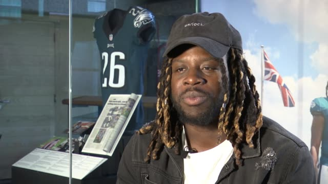 jay ajayi exhibition in museum of london england london museum of london int jay ajayi interview sot ajayi with leg in brace chatting to reporter... - leg brace stock videos and b-roll footage