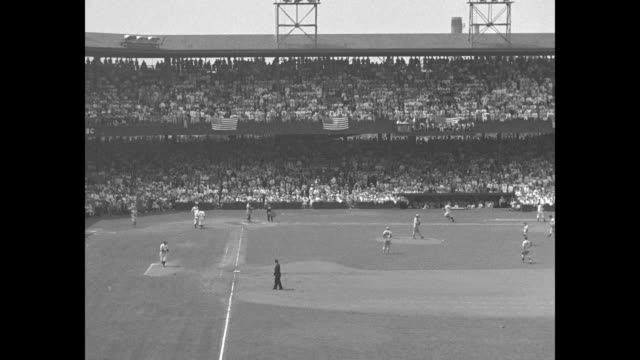 jay dizzy dean on the mound for the national league team at the allstar game in washington dc / cu rear shot lou gehrig at bat for the american... - 1937 stock-videos und b-roll-filmmaterial