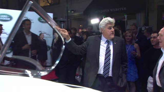 jay leno, ian callum at the jaguar land rover unveil of the new xkr-s convertible at beverly hills ca. - tv司会 ジェイ・レノ点の映像素材/bロール