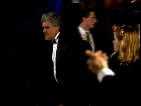 jay leno walks past paparazzi as they take his photo. - vanity fair oscar party stock videos & royalty-free footage