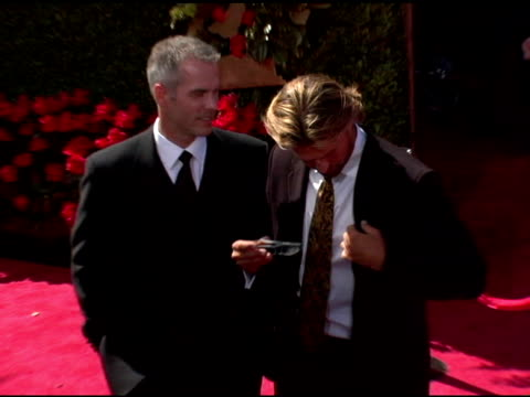 vídeos y material grabado en eventos de stock de jay overbye and byron velvick of 'the bachelor' at the 2006 primetime emmy awards arrivals at the shrine auditorium in los angeles, california on... - premio emmy anual primetime
