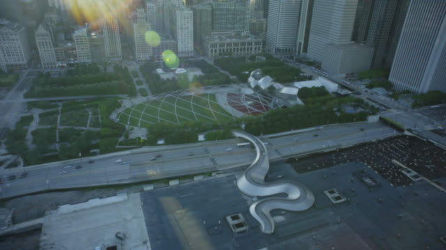 ws pov jay pritzker pavilion in city - motorway junction stock videos & royalty-free footage
